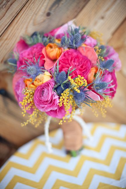 bouquet is my favorite! I don't know what the dusty blue flowers are, but i'm loving them.