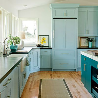 Bold #Kitchen Color | Aqua cabinets give a cool 1950s feel. This ideal shade is Benjamin Moore's Kensington Green. White walls, absolute black granite countertops, and white marble on the island balance the strong color.