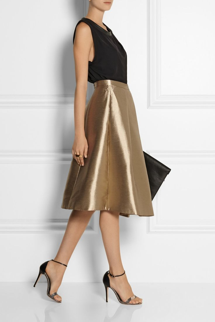 TIBI Halcyon metallic pleated taffeta skirt DION LEE Leather-trimmed draped crepe top VICTORIA BECKHAM Leather clutch
