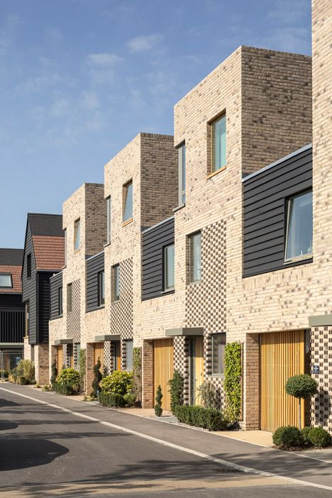 Chequered brickwork brings unity to a Cambridge housing community by Proctor and Matthews.