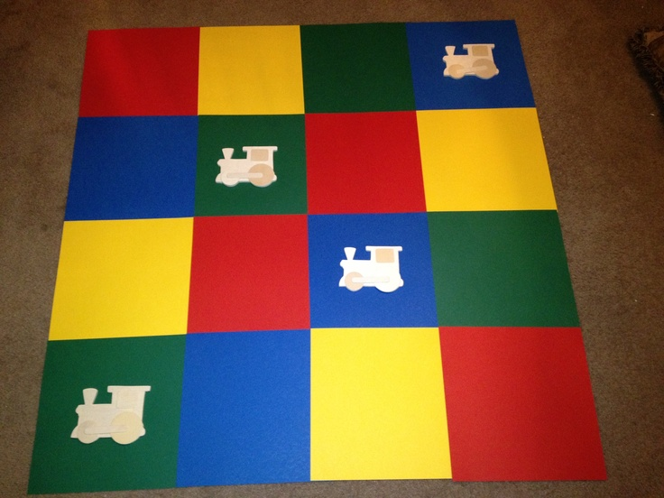 Wall Backdrop made from colored scrapbook paper, tape, & carved wooden trains...super easy to create #AgapeAffairs #WallArt