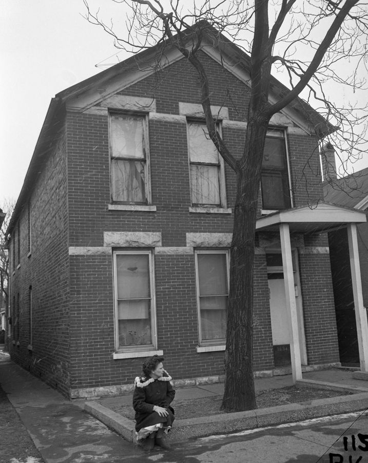Loretta Grimes sitting outside her home at 3634 S. Damen ...