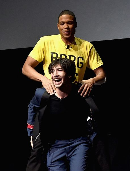 Actors Ezra Miller and Ray Fisher mess around onstage at CinemaCon 2017.