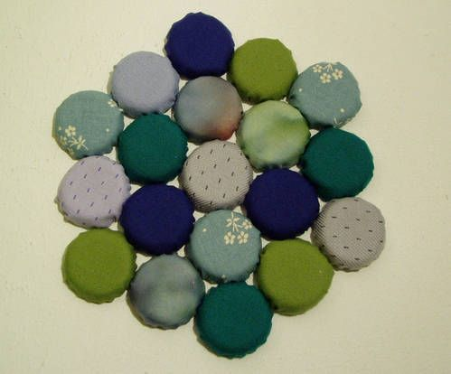 Another bottle cap project--cover with fabric and stitch together for a coaster or trivet.  Easier than the crocheted version.