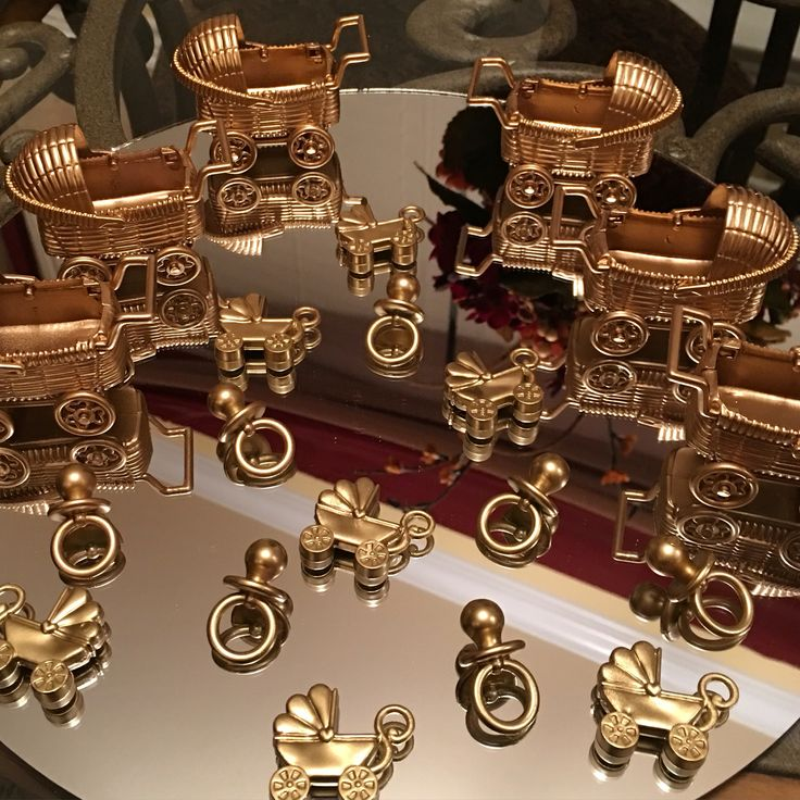 DIY paint carriages gold for a fancy baby shower.
