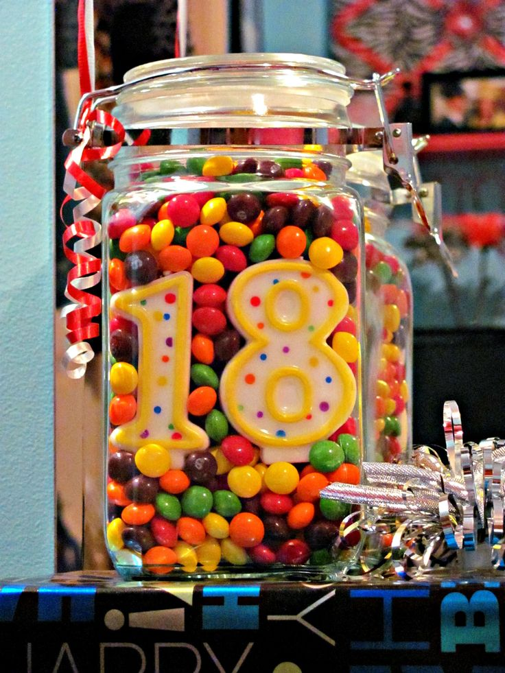 Skittles in a mason jar with bday candles!