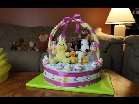 In this video Thom shows you how to make a cool Diaper Cake that resembles a gift basket. Just another fun way to show your friends or family how much you care. Thank you for watching!    Diaper Cake - Gift basket - Baby Shower - How To - Nappy Cake