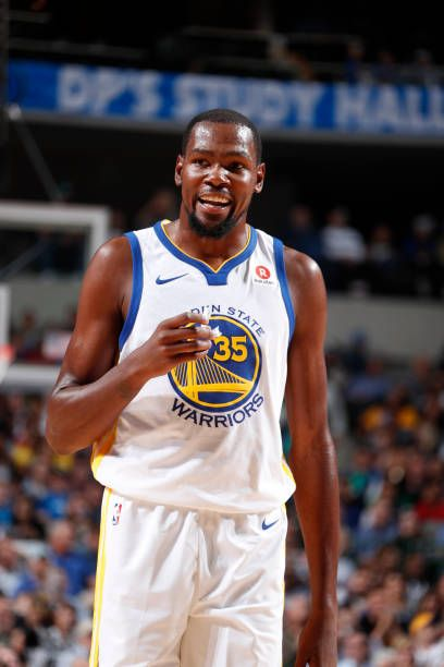 Kevin Durant of the Golden State Warriors reacts during the game against the Dallas Mavericks on October 23 2017 at the American Airlines Center in...