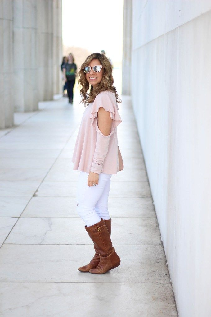Lifestyle blogger Roxanne Birnbaum of Glass of Glam wearing a Red Dress Boutique pink ruffle top, Old Navy distressed denim, and a JustFab rose gold bag