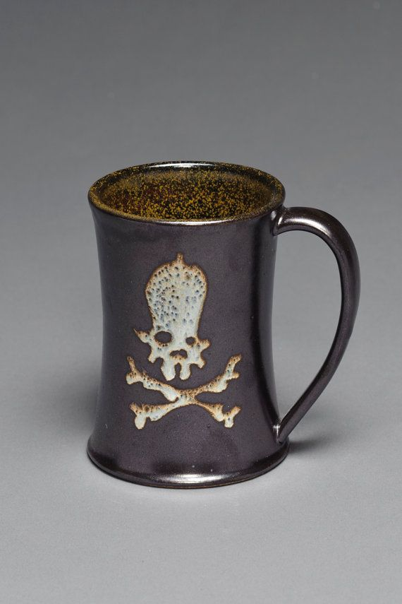 black & amber skull and bones mug | microwave, dishwasher, and food/drink safe | skull ceramics from Tire City Potters