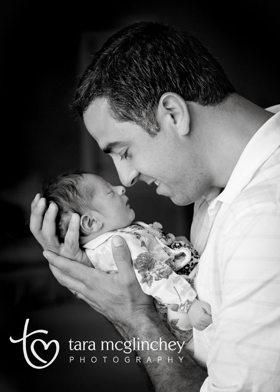 Father and newborn baby girl pose for nj newborn photographer www taramcglinchey com