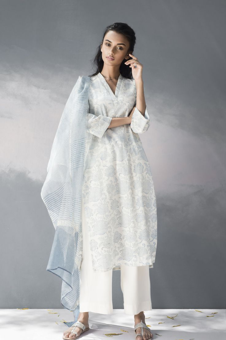 CHERRY BLOSSOM SUMMERS Sasual daywear features Kalamkari handblock prints in natural indigo dye and mogra with traces of embroidery that accentuate these light-as-air silhouettes.