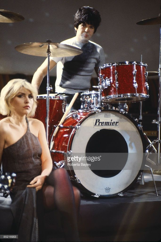 Photo of Debbie HARRY and BLONDIE and Clem BURKE; Debbie Harry & Clem Burke (playing Premier drum kit, drums) on the set of the 'Heart of Glass' video shoot