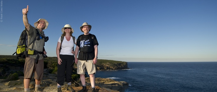 Senior guide Ian Wells leads walkers along the stunning cliffs of Royal National Park's coastline
