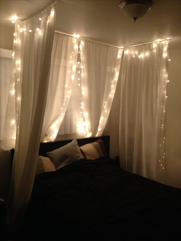 "DIY bed canopy under $50! Joann's 84"" home sheer fabric, painted wooden dowels, white ceiling hooks, Christmas lights, and a stapler. No sew! Less than an hour."