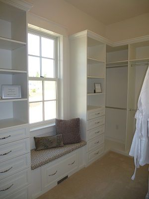 ~Idk when we would sit there, but I love the look. Tbe window facing neighbors, shelves/drawers to the left, hanging to the right...~mMaster Closet - Southern Living Showcase Home...yup, now we dont need dressers in the bedroom :) Perfect for our next flip!