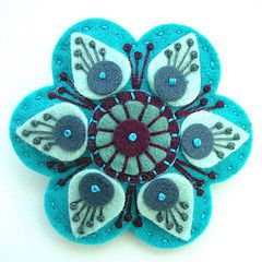 Felt Flower... links to a flickr acct with LOTS of beautiful felt work