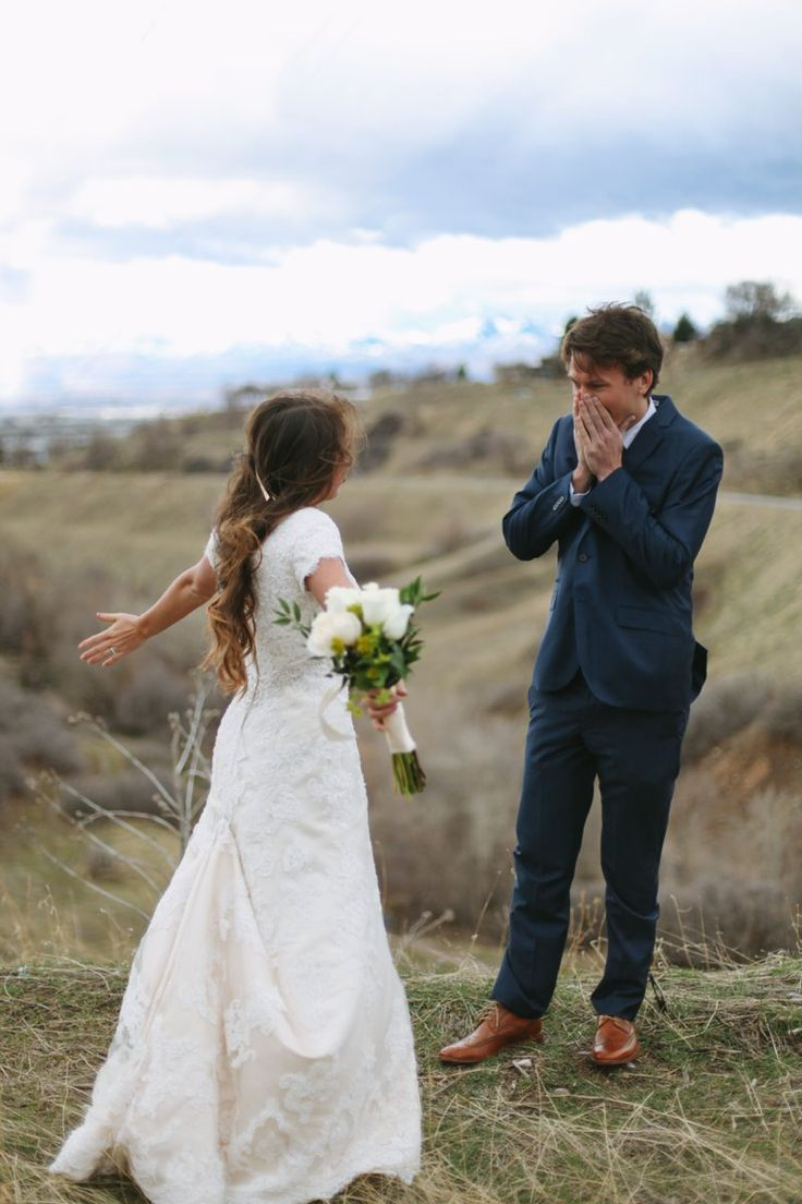 This picture is just beautiful...modest dress, beautiful bride, and the look on his face is perfect. Really looks like he treasures her :)
