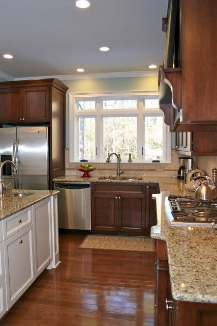 Looks very similar to my new kitchen with the dark cabinets, wood floor and white island.  Love it!!