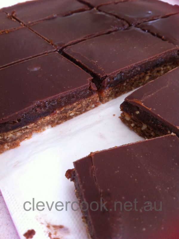 Healthy Chocolate Caramel Slice (Thermomix) 120g mixed nuts of your choice 70g dates or prunes (I use a 60/40 mix) 30g coconut butter 20g tapioca starch or rice flour 1 teas cinnamon 210g pitted dates (I use a few prunes in there to cut down the sweetness) 2 tablespoons of macadamia butter  1 or 2 tablespoons of water