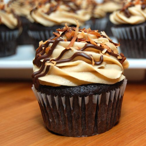 Samoas Cupcakes. Seriously? A cupcake version of my fave G.S. cookie? I'm so trying this!