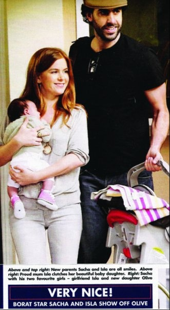 Cute Baby Borat: Sacha Baron Cohen and his partner Isla Fisher taking their first stroll in LA with Baby daughter Olive. Spot the beautiful Bonnie Baby Cashmere Blanket draped over the car seat.