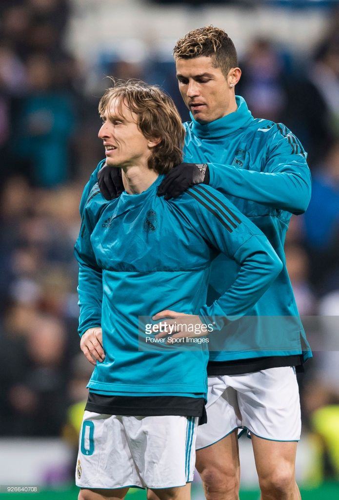 67e0589bad073 Cristiano Ronaldo of Real Madrid gives teammate Luka Modric a should  massage prior to the UEFA Champions League 2017-18 Round of 16 (1st leg)  match between ...