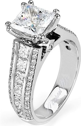 Michael M. Triple Row Diamond Engagement Ring : This diamond engagement ring by Michael M. features princess cut diamond channel set in between two rows of pave set round brilliant cut diamonds as well as a surprise diamond underneath the center stone of your choice.