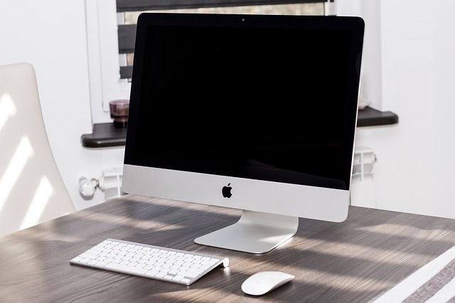 iMac on a wooden desk, next to Apple keyboard and mouse. Place your iOS app screenshot in this image without Photoshop on Picapp.net #iMac #office #business #mockup
