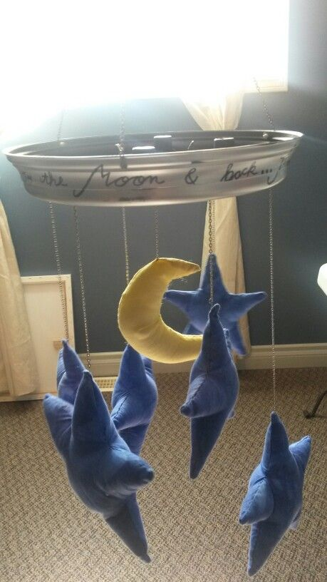 """I love you to the moon and back... through the stars and into the sea"" clock mobile."