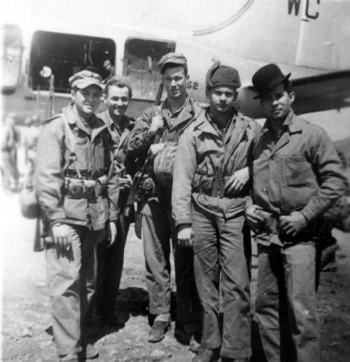 Five Marines posing outside an airplane. http://digitallibrary.usc.edu/cdm/ref/collection/p15799coll48/id/4324