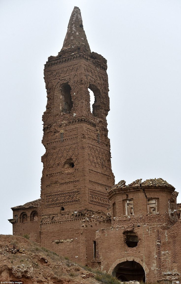 A second attack was accompanied by a diversionary assault, and allowed the Americans to enter the town . Above , the entrance of San Martin de Tour chirche stands in the ruins of Belchite village