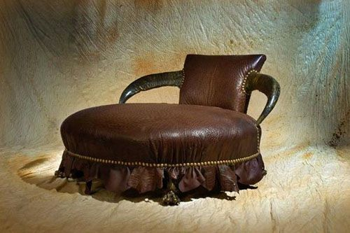 by Michel Haillard working with leather and real horns
