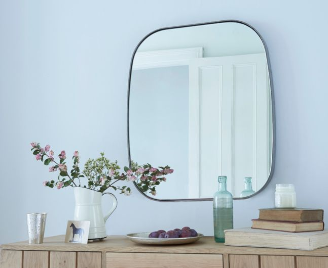 ALBIE MIRROR. We craft the über-thin frame of this vintage steel mirror by bending it again and again.