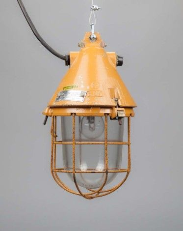 Conical well-glass pendant light with removable cage    This orange-colored splash-proof light consists of a die-cast aluminum casing fitted with a heat-resistant safety glass. This lamp is a later ve...