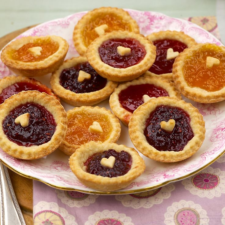 Little tarts of jammy sweetness. Perfect to make with a selection of homemade jams. Afternoon tea is just not the same without this Mini Jam Tarts Recipe!