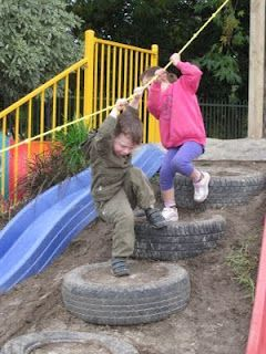 climbing tires hill rope climb slide on dirt outdoor play area; I *really* need something like this for my daughter so she won't have to keep using the furniture!