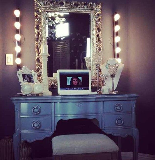 This! I love the ornate mirror and the surrounding bulbs, you don't have to sacrifice beauty for practicality!