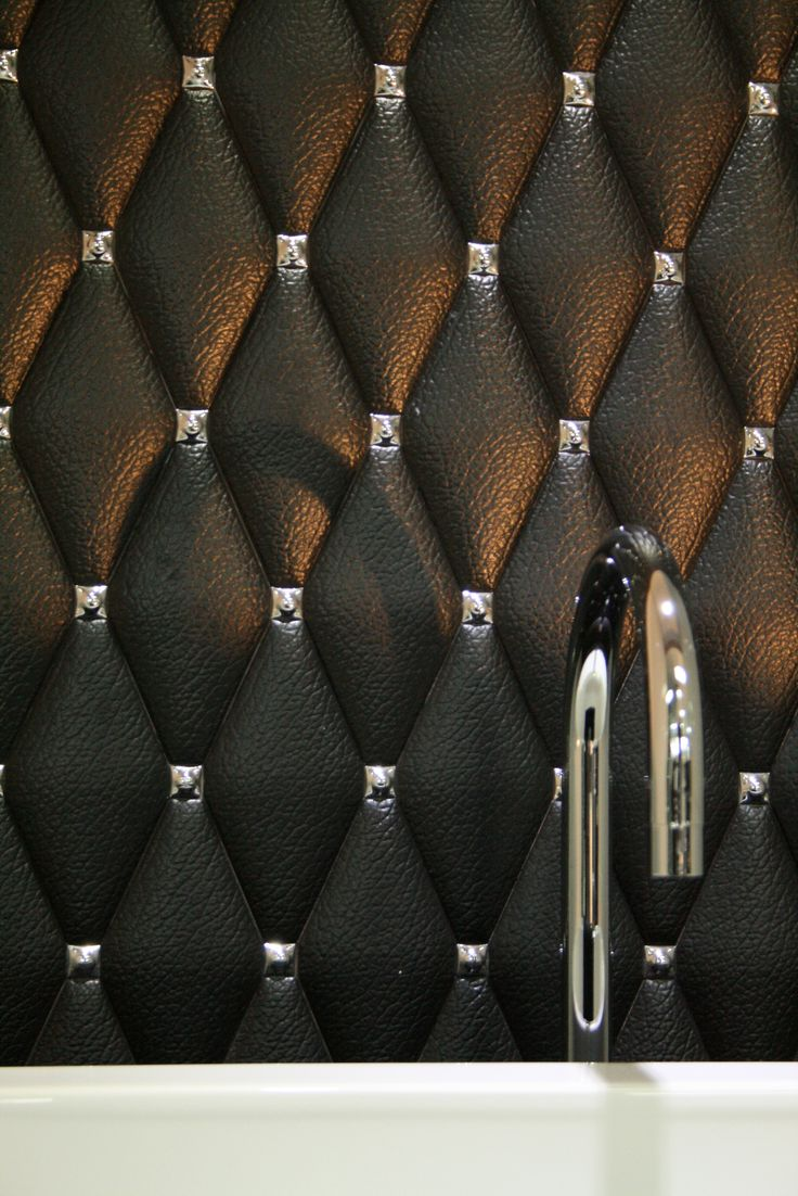 Diamond shape ceramic wall tiles in black leather effect with chrome studs