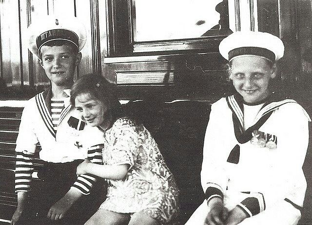 Tsarevich Alexei of Russia with his cousins Princess Ileana and Prince Nicholas of Romania.