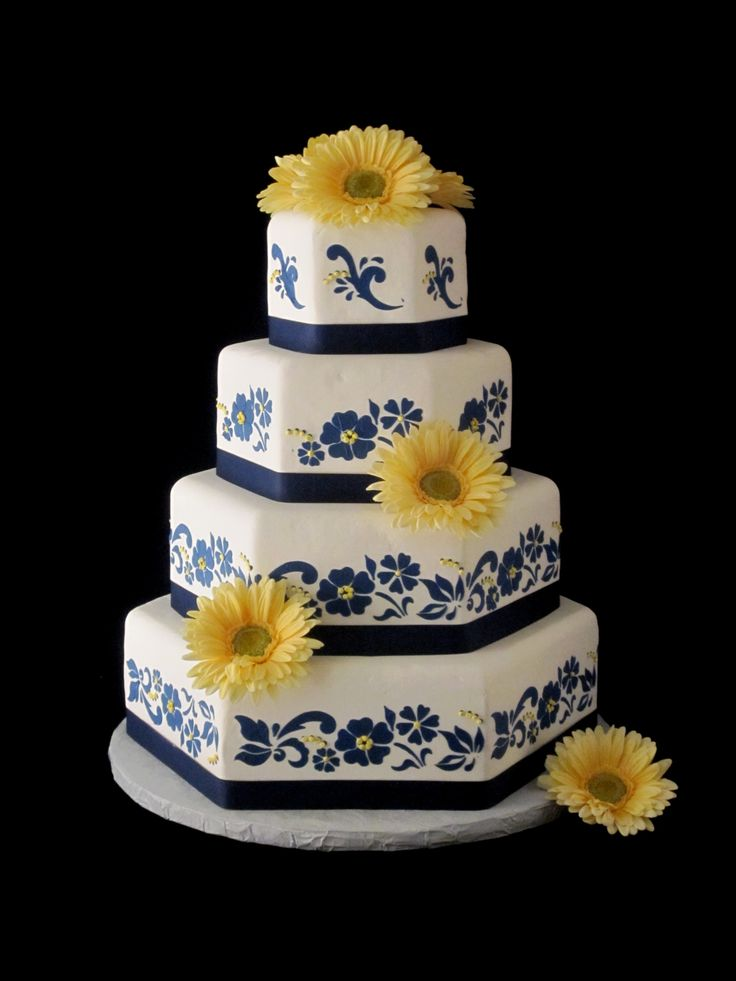 elegant navy and yellow from the Twisted Sifter Cake Shoppe -   - http://thetwistedsifter.files.wordpress.com/2011/01/yellow-gerber-daisy-navy-blue-and-white-wedding-cake.jpg