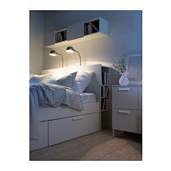 Perfect for things you want to reach from your bed. One shelf is adjustable to 3 different positions. The top shelf has holes for cords to lamps or chargers.