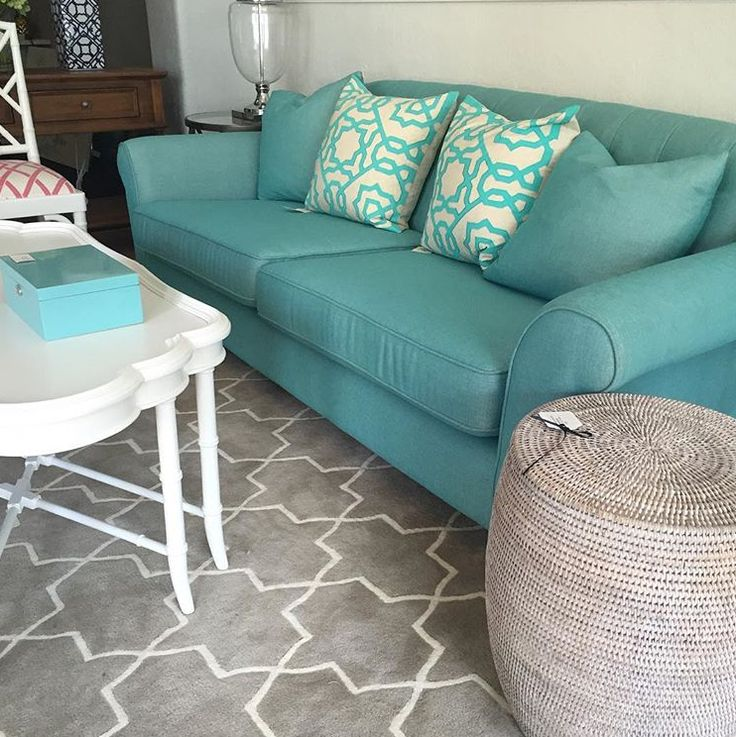 Doesn't this aqua sofa look divine with our White Wash Drum Table? A beautiful combination!  www.rgimports.com.au