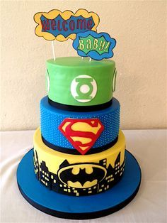 - AppleMark super hero baby shower cake. The toppers are made of paper.