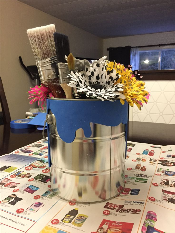 Flower vase paint-can with paint pouring over the top and assorted paintbrushes bidding