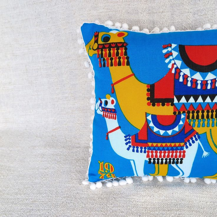 """The """"Pesky Camel"""" cushion. Handmade using a 1978 tea towel that has never been used."""