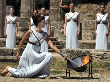 These dresses are gorgeous.  Olympic torchlighting 2017