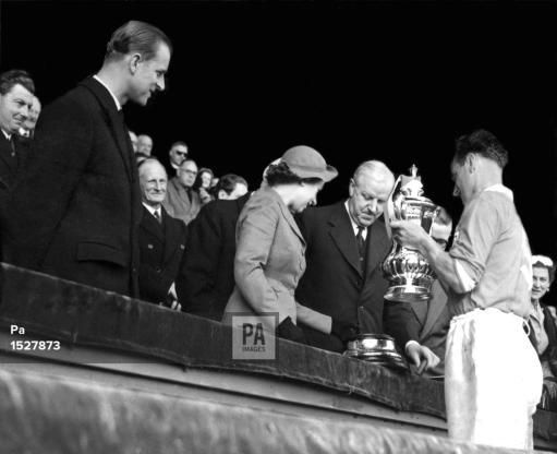 Amid scenes of unrestrained enthusiasm, Blackpool FC captain Harry Johnston led his men up to the Royal Box at Wembley to receive the F.A. cup from the Queen. They beat Bolton Wanderers 4-3 in the Cup Final.