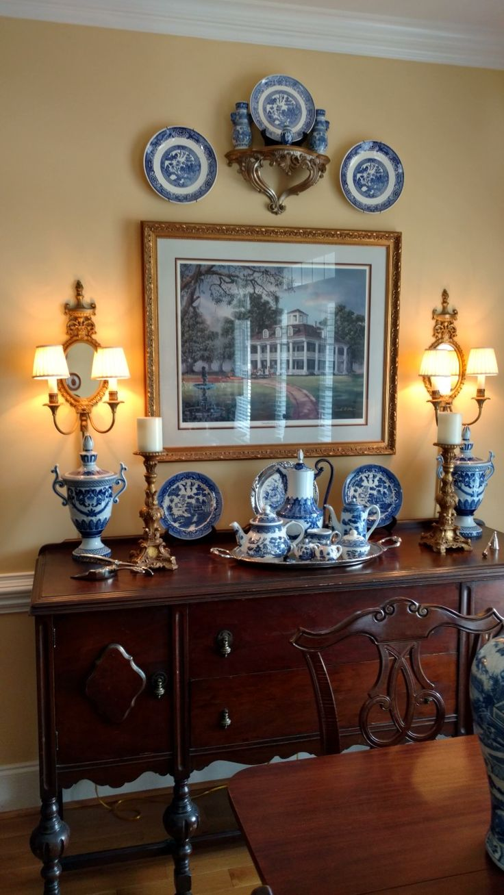 Like the wall color, but I would paint our antique buffet a dark French blue