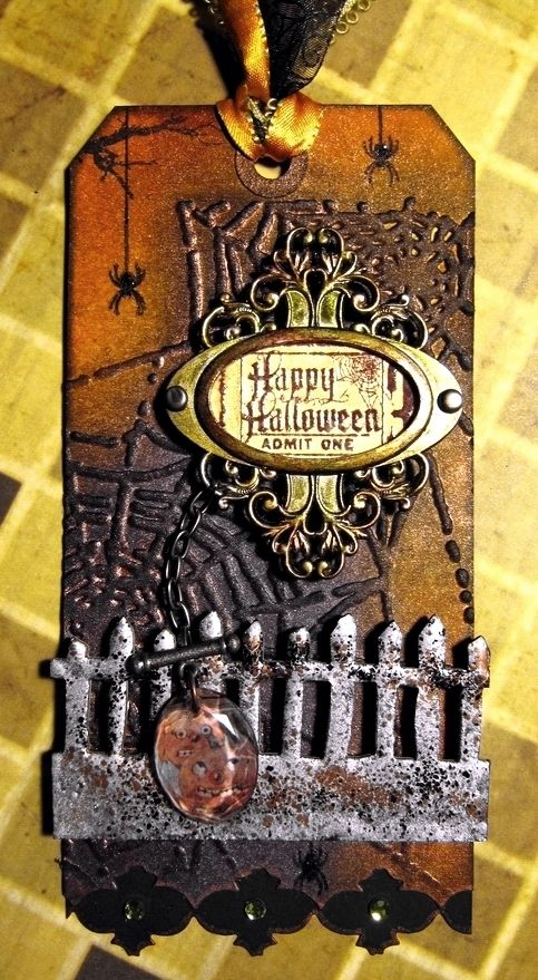 Halloween Tag, metal embelishments. Orange background. Spiders web. Silver metal style fence.